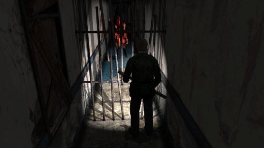 Silent_Hill_2_-_Pyramid_Head_in_Woodside_Apartments_hallway